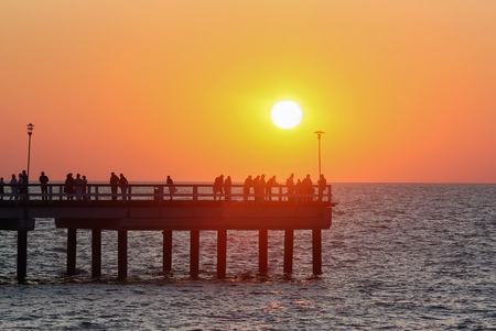 pierce: view of sunset in Palanga with Pierce, Lithuania Stock Photo