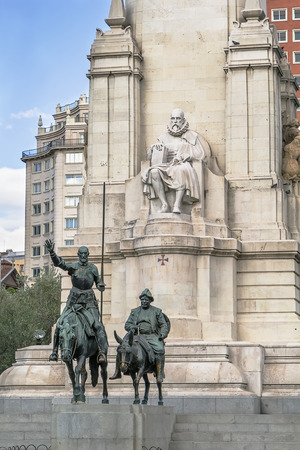 sculpture of Miguel de Cervantes and bronze sculptures of Don Quixote and Sancho Panza on Cervantes Monument, Madrid, Spain