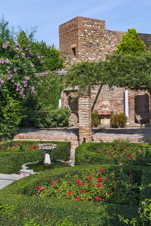 palatial: The Alcazaba is a palatial fortification in Malaga, Spain. Indoor garden Editorial