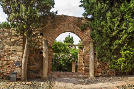 palatial: The Alcazaba is a palatial fortification in Malaga, Spain. Arch in the Garden Editorial