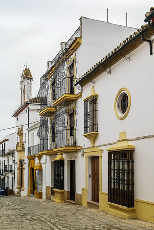 historical building: street with historical building in Ronda city center, Spain