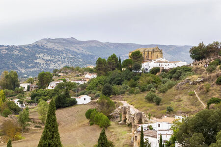 view of the outskirts of Ronda with Holy Spirit Church, Spain photo