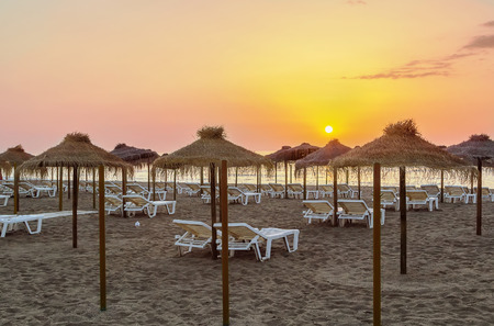 Sunrise. Beach in the resort of Torremolinos, Spain