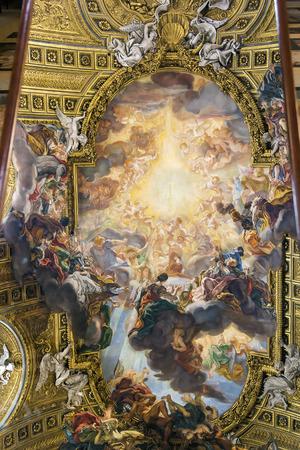 grandiose: ceiling fresco, the grandiose Triumph of the Name of Jesus by Giovanni Battista Gaulli in Church of the Gesu, Rome (reflection in the mirror)