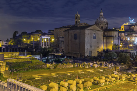 The Roman Forum is a rectangular forum (plaza) surrounded by the ruins of several important ancient government buildings at the center of the city of Rome. Evening photo
