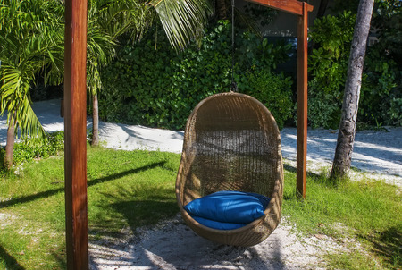 topical: Chair-swing  for relaxation in topical island, Maldives Stock Photo