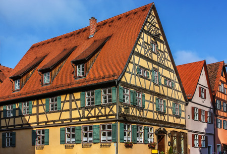 place of interest: Street with historic houses in the Dinkelsbuhl city center. Dinkelsbuhl is old Franconian town, one of the best-preserved medieval urban complexes in Germany.