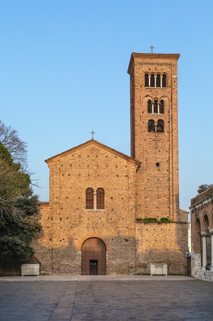 aisles: The St. Francis basilica, rebuilt in the 10th – 11th centuries over a precedent edifice dedicated to the Apostles. Behind the humble brick facade, it has a nave and two aisles. Stock Photo