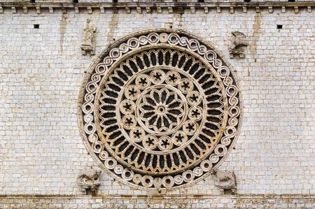 Rose-window in Basilica of St. Francis of Assisi, Italy photo