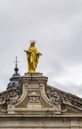 angeli: The gold-plated statue of the Madonna degli Angeli on top of the facade of Basilica of Santa Maria degli Angeli, Assisi