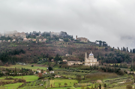 montepulciano: View of Montepulciano with San Biagio in rainy weather, Italy