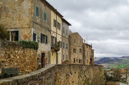 pienza: The Southern Walls of Pienza with houses, Italy