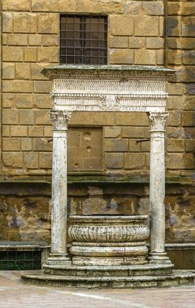 pienza: Old fountain on cathedral square in Pienza, Italy Stock Photo