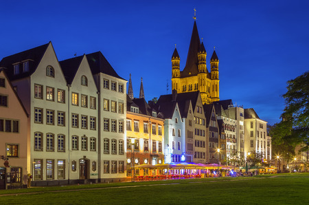 church tower: Evening. View of historic houses on the Rhine promenade in Cologne with Great St. Martin Church, Germany