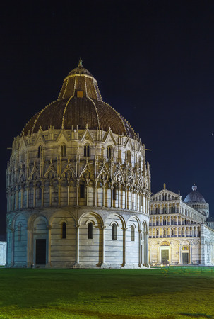 begun: Evening. Pisa Baptistry stand on Piazza dei Miracoli in Pisa.The round Romanesque building was begun in the mid 12th century. It is the largest baptistery in Italy Stock Photo