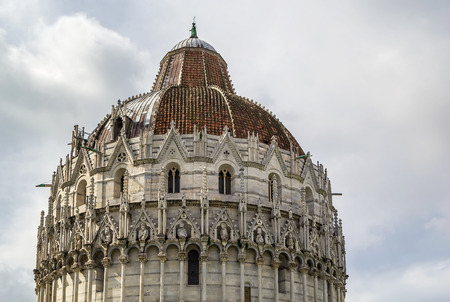 begun: Pisa Baptistry stand on Piazza dei Miracoli in Pisa.The round Romanesque building was begun in the mid 12th century. It is the largest baptistery in Italy. Dome Editorial