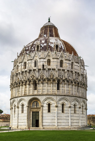 mid century: Pisa Baptistry stand on Piazza dei Miracoli in Pisa.The round Romanesque building was begun in the mid 12th century. It is the largest baptistery in Italy