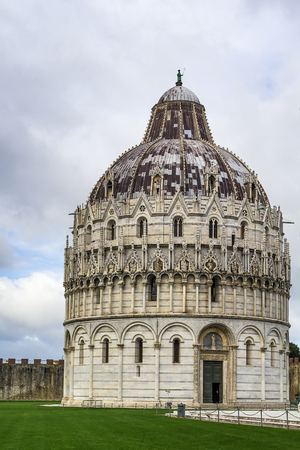 begun: Pisa Baptistry stand on Piazza dei Miracoli in Pisa.The round Romanesque building was begun in the mid 12th century. It is the largest baptistery in Italy