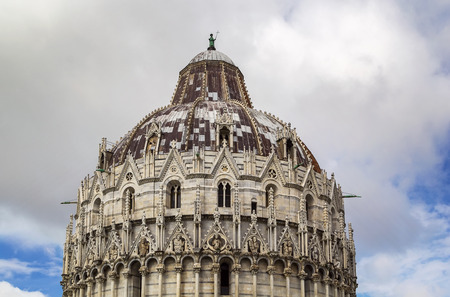 begun: Pisa Baptistry stand on Piazza dei Miracoli in Pisa.The round Romanesque building was begun in the mid 12th century. It is the largest baptistery in Italy. Dome Stock Photo