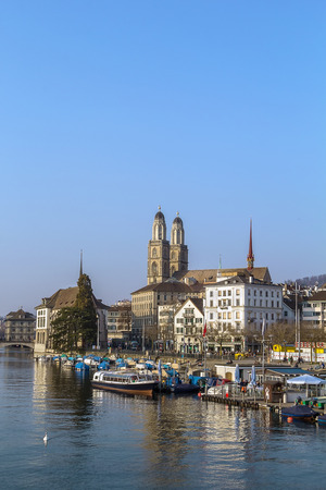 grossmunster cathedral: view of embankment of Limmat river with Grossmunster church, Zurich, Switzerland