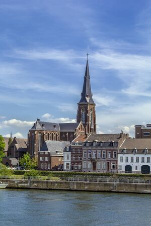 meuse: view of Embankment of Meuse river with church, Maastricht Stock Photo