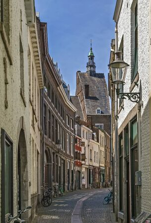 historical building: street with historical building in Maastricht city center