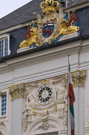city coat of arms: coat of arms and clock on facade of the Old City Hall of Bonn, Germany Stock Photo