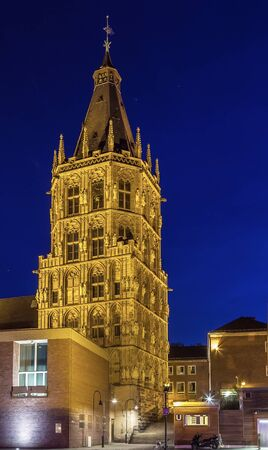 historical building: The City Hall tower is a historical building in Cologne, Germany. Evening