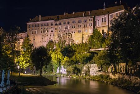 vltava: view of Cesky Krumlov castle from Vltava river at night, Czech republic Editorial