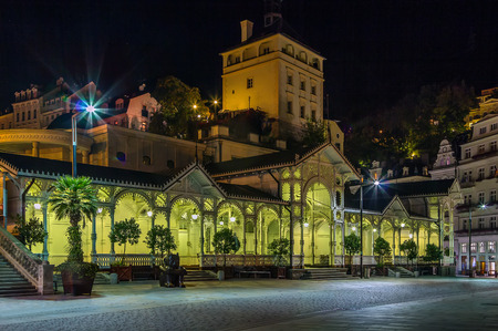 gabled: Market Colonnade is covered by the gabled roof and it is surrounded by wooden walls on three sides. Evening in Karlovy Vary Editorial