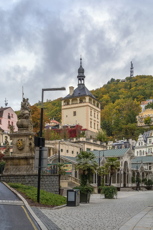 karlovy: city centre of Karlovy Vary with Holy Trinity Column and Market Colonnade, Czech Republic Stock Photo