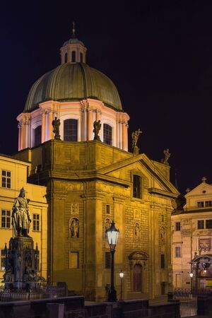 st charles: Church of St Francis Seraph is early Baroque church is located next to the Charles Bridge, Prague, Czech republic. At night