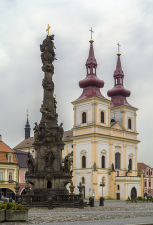 exaltation: Church of the Exaltation of the Holy Cross and Holy Trinity Column are situated on main square of Kadan, Czech republic