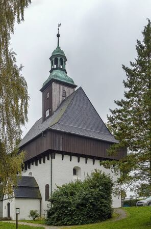 evangelical: battlement church (Wehrkirche) is Evangelical Lutheran Church building in Lauterbach, a suburb of Marienberg, Germany Stock Photo
