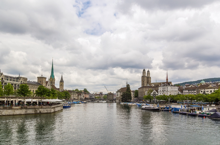grossmunster cathedral: View of Limmat river with main church in Zurich, Switzerland