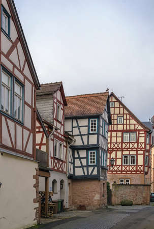 renovate old building facade: street with historical half-timbered house in Budingen, Hesse, Germany