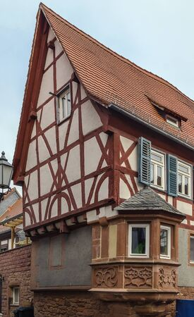 renovate old building facade: half-timbered house with bay window in Budingen, Germany