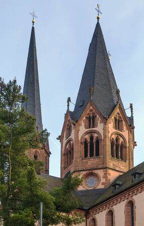 st german: Church On St. Mary, Gelnhausen, Germany.  It shows both Romanesque and Gothic architecture elements. Stock Photo