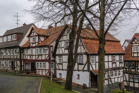 renovate old building facade: street in Schlitz with half-timbered houses, Germany
