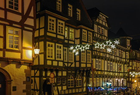 renovate old building facade: Street in Marburg old city at night, Germany