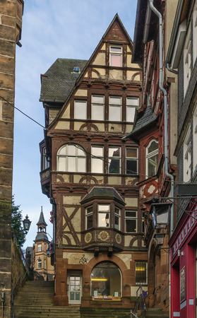 renovate old building facade: street in Marburg with half-timbered houses, Germany