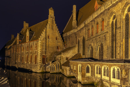 memling: view of Old St. John Hospital from canal in Bruges at evening, Belgium Stock Photo
