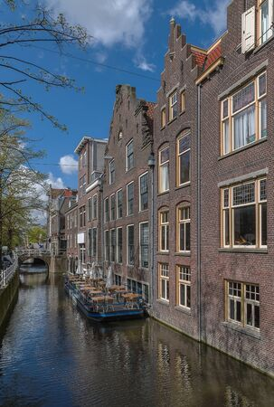 delft: view of houses along the canal in Delft, Netherlands