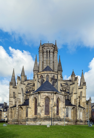 buttresses: Coutances Cathedral is a Gothic Roman Catholic cathedral constructed from 1210 to 1274 in the town of Coutances, Normandy, France Stock Photo