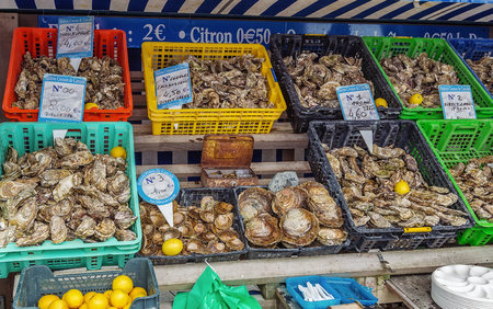 aphrodisiac: Showcases for sale oysters on the waterfront of Cancale city, France Stock Photo
