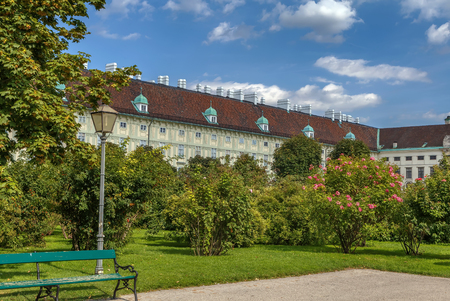View from Volksgarten (Peoples Garden) to Hofburg Palace in Vienna, Austria. View Editorial