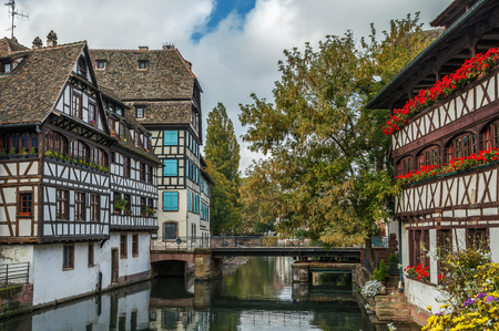 View of embankment of the Ill river in  Petite France district with Maison des Tanneurs (tanners house), Strasbourg, France