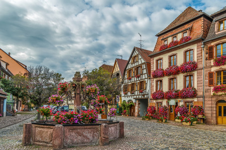 Square with fountain in Bergheim, Alsace, France Stock Photo