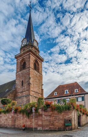 touristy: Catholic parish church was built with red sandstone in the 14th century, Bergheim, Alsace, France
