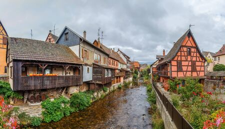 View of Weiss river with historical houses in Kaysersberg, Alsace, France